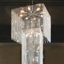 large modern swarovski crystal stairwell chandelier