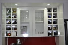 overhead framed glass door display cabinet with side wine racks