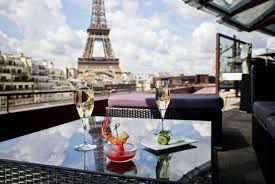 dining with eiffel tower view. restaurant les ombres dining with eiffel tower view justluxe.com