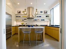 the open shelves in this kitchen are used to display the daily plates mugs and serve ware with the top shelves used as a place to display favorite pieces