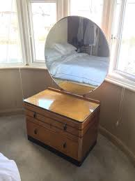 vintage dressing table with large round mirror