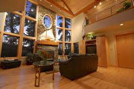 Light hardwood floors dark furniture Beach House This Living Room Has Large Row Of Windows Lining The Front Wall The Hardwood Home Stratosphere 22 Living Rooms With Light Wood Floors pictures