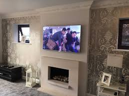 tv above fireplace too high solutions credainatcon