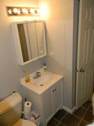 over bathroom cabinet lighting. Bathroom Vanity Lights Over Medicine Cabinet Lighting Above Surface Light Extension Box Bennett Triple Sconce From
