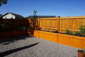 this is a wonderful residential fence complete with a raised garden which serves as a flower box this family needed a better option for their gardening