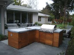 Love the wood cabinets for the outdoor kitchen. Where can I get them? What  type of wood are they made of?