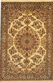 cream colored nain rug made in the city of nain in iran