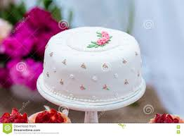 beautiful white wedding cake with flowers outdoor shabby chic style beautiful shabby chic style