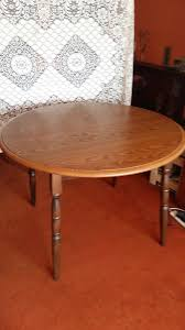 round extendable dining table and bureau with 4 drawers