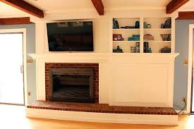 what ugly fireplace covering brick with tile stone wood m l f