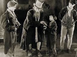 oliver twist film  oliver twist jackie coogan held captive by fagin lon chaney and his criminal gang