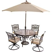 hanover 5 piece outdoor dining set with round glass table swivel chairs umbrella