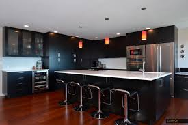 black kitchen with red pendant lights