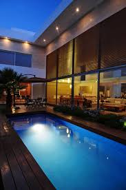 Swimming Pool:Amusing Contemporary Swimming Pool Design With Cement Slope  Wall As Waterfall Ideas Glamorous