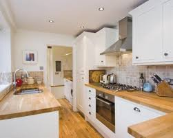 wood kitchen furniture. Photo Of White Kitchen With Sunken Sink Tiled Splashback Tiles Wooden Worktop Floor Wood Furniture