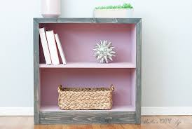 pink and grey laminate bookshelf makeover the after interior is pink and the outside