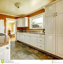 Orange And White Kitchen Orange Kitchen Room With White Cabinets Royalty Free Stock Photo