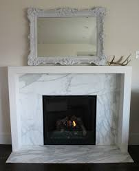 white marble fireplace surround by the granite gurus before after calacatta gold