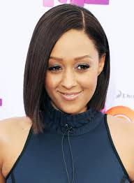tia mowry with a short straight brunette bob hairstyle pictures