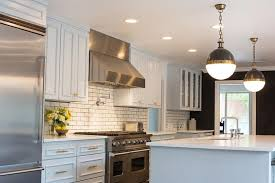 kitchen with white subway tiles and dark grout