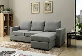 small sofa is sectional and modular with an ottoman section in gray fabric nonagon