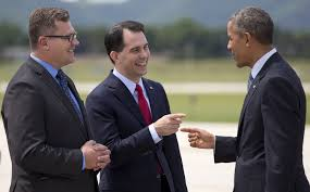 President Barack Obama is greeted by Wisconsin Gov. Scott Walker (middle)  and La