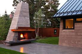 contemporary outdoor fireplace kits concrete mantel with lawn patio and modern ottomans footstools backyard 7