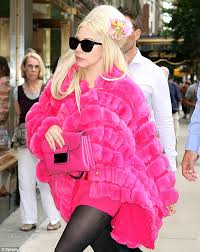new purchase the singer exited the giorgio armani in a hot pink fur coat