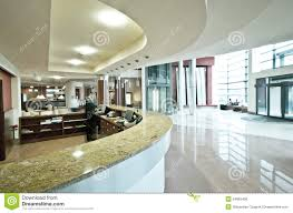 Modern hotel reception desk. Interior of stylish modern hotel showing lobby  and curved reception desk