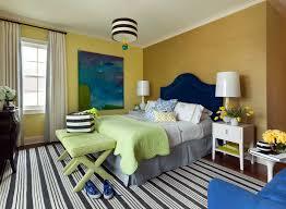 Colorful Bedroom With Black And White Striped Rug