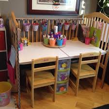 we upcycled our old drop side crib into an art desk along with a
