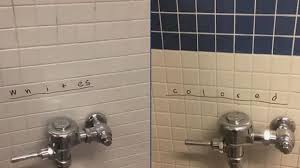 high school bathroom. Principal Kevin Ahern Said The Graffiti Was Immediately Removed And He Held A Thursday Morning School Wide Assembly, Telling Students To Unite Not \ High Bathroom