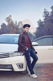 Stylish boy standing with his awesome car