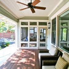 comfy brown wooden sunroom furniture paired. covered porch features wicker armchairs u0026 dark wood flooring comfy brown wooden sunroom furniture paired r