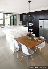 great idea dining table integrated with the kitchen bench top for entertaining or family time