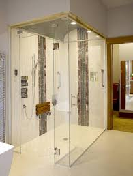 the zero threshold steam shower is accented with a series of ceramic and glass tiles the barrel vaulted ceiling is tiled in 1 inch glass mosaic tiles and a