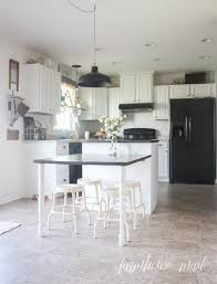 migrating from knotty alder to grey kitchen cabinets is a budget friendly way to give