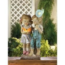 solar children garden statue