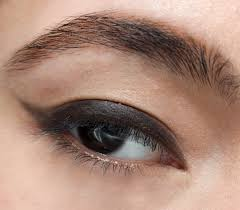 step 4 take an eyeliner brush and a matte black eyeshadow to create a wing create a line from the edge of your bottom lash line and drag the line up at an