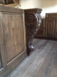 kitchen island features 36 charcoal tuscan corbels
