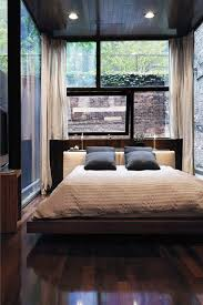 Small Bachelor Bedroom With Glass Window