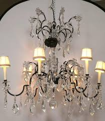 a holly hunt wrought iron and crystal scroll form chandelier from a spectacular home on