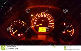Yellow Light On Speedometer Car Dashboard Dials With Illuminated Meters Stock Image