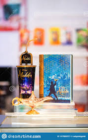 An Aladdin 2019 Promotional Items Such As Popcorn Container And Soft