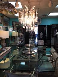 lucite chandelier 300 00 vintage karges chairs silver leather needs reupholstering glass top table wooden cut out base 500 00 silver plate punch bowl on