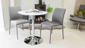 grey fabric dining chairs and white gloss dining table