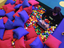 the google office. laptop ball pit working fun office the google