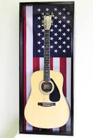 oak finish walnut finish cherry finish guitar display case with us flag background