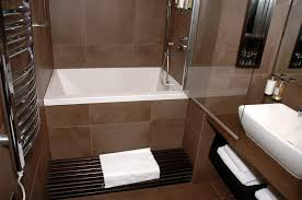 Small Soaking Bathtub / Shower combo Great for small bathrooms; deep tub  for soaking;