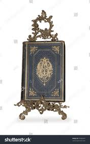 old book on gold stand